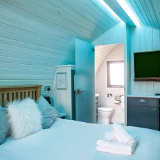 Glamping blue pod bedroom with en suite