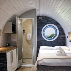 Glamping grey pod bedroom with en suite