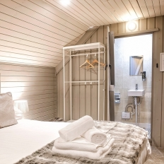 Glamping pod bedroom with en suite