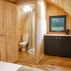 Glamping wooden pod bedroom with en suite