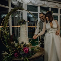 Leah-and-Rhys-Cutting-The-Cake-Oldwalls-Gower-Winter-Wedding