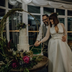 Leah-and-Rhys-Cutting-The-Cake-Oldwalls-Gower-Winter-Wedding-