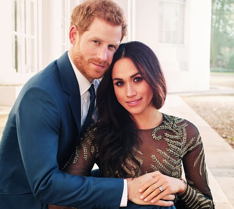 An image of Prince Harry and Meghan Markle holding each other.