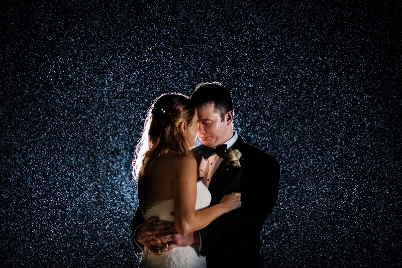 An image of a couple dancing in darkness.