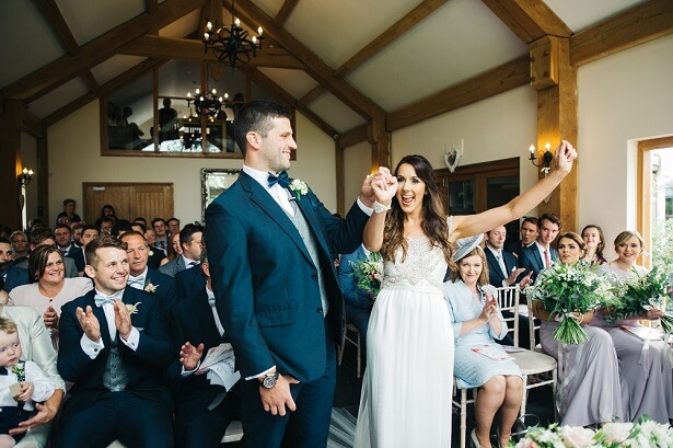 Bride and groom celebrating after exchanging vows at a wedding ceremony