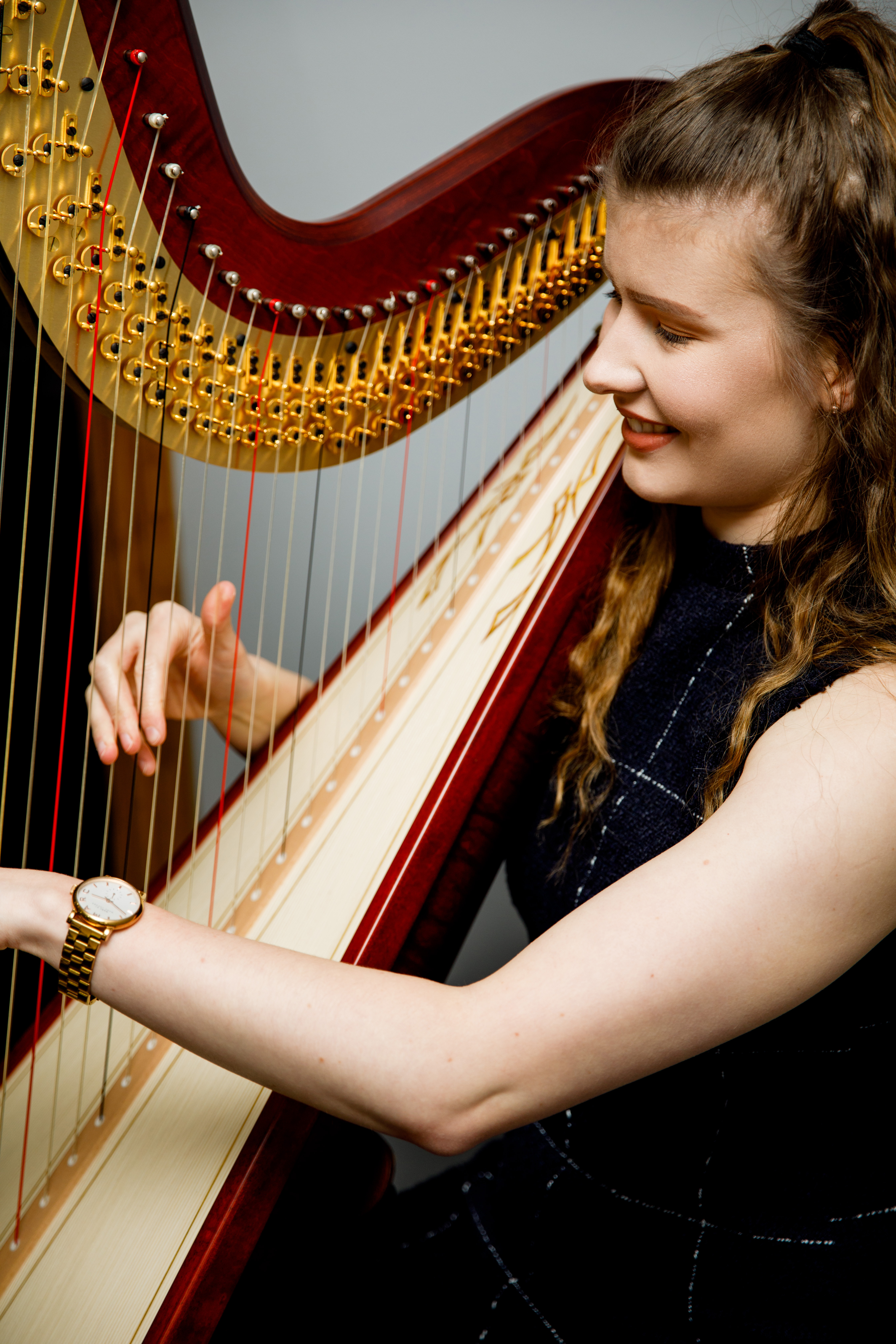 harpist playing at a wedding