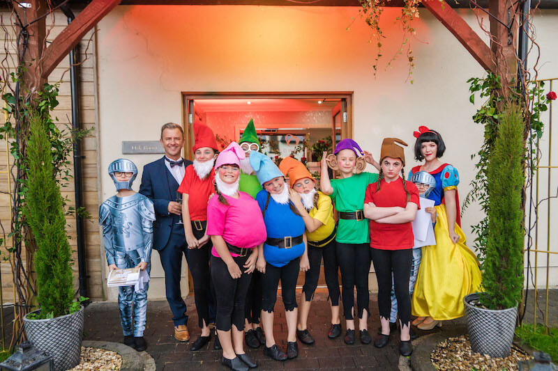 Guests and children dressed up as the seven dwarves fro Disney for the charity ball at our south wales wedding venue at oldwalls